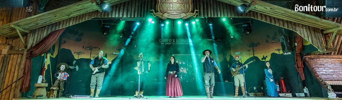 show_tipico_churrascaria_garfo_e_bombacha